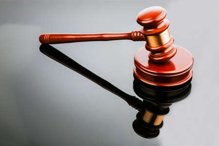 decisionmaking: judge or auction hammer symbol photo for authority and decision-making