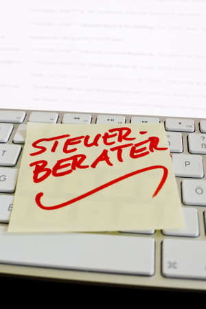 auditors: a sticky note on the keyboard of a computer is a reminder  accountants