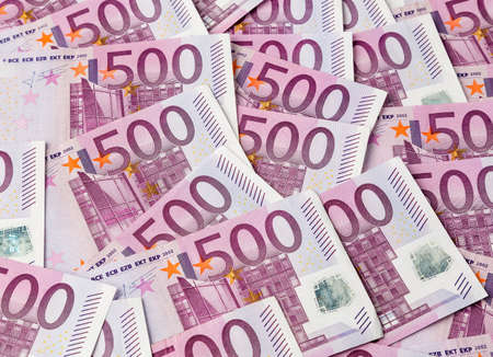 euro banknote: many of five hundred euro banknotes lie side by side  photo icon for wealth and investment Stock Photo