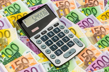 mathematically: stethoscope and euro bills  symbol photo for costs, revenue, taxes