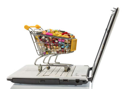 shopping cart with tablets and computers  photo icon for the purchase of drugs on the internet Stock Photo - 19419900