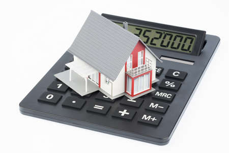 immobilien: residential building on a calculator, photo icon for house purchase, costs and savings