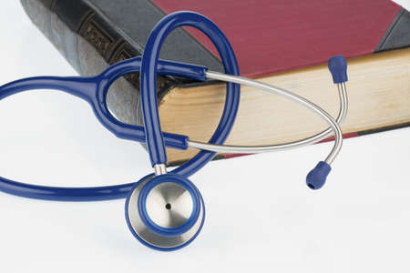 quite time: book and stethoscope, symbol photo for bungling, medical errors and expertise