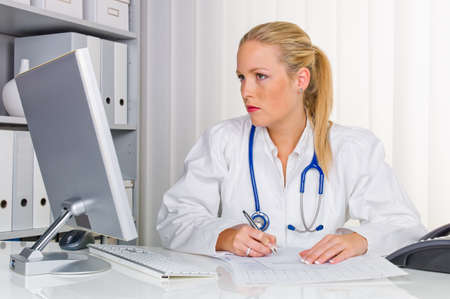 familiy: a young ã  health care professional with stethoscope in her doctor s office  Stock Photo