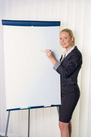 a young woman with a flip chart in a presentation board  training and adult education  photo