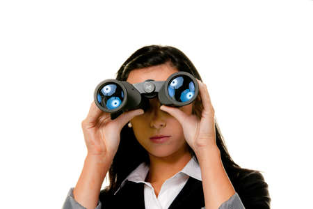 young woman with binoculars looking to the future photo