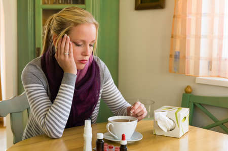 bedridden: woman on sick leave with tea and medicines  cold, cold and flu season