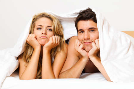 unfaithful: a young couple in bed has problems and crisis  divorce and separation