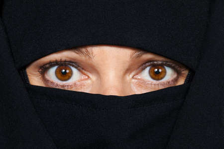 symbolfoto islam  muslim burqa is with obscured  photo