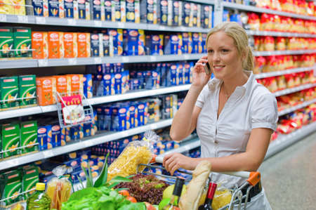 local supply: a woman when buying groceries in a supermarket  everyday life of a housewife