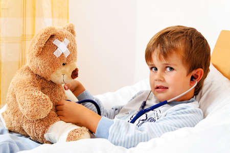 sick teddy bear: a sick child examined teddy with stethoscope