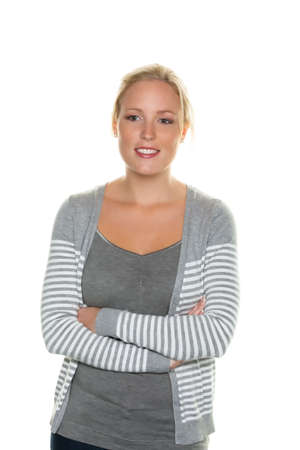 sympathetic: sympathetic young woman standing against white background  half figure
