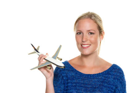 modell: a young woman with the model of an aircraft looking forward to your next vacation