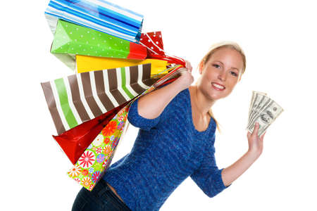 turnover: a young woman with colorful shopping bags while shopping  with dollar banknotes