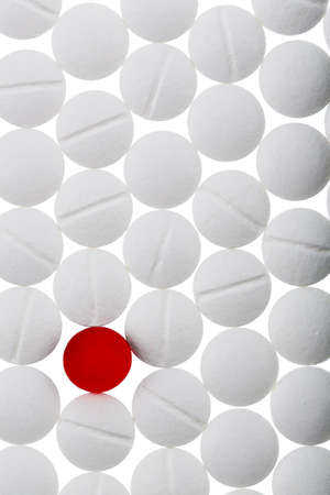 medical services: white tablets in contrast with a red tablet, symbolic photo for bullying and individuality
