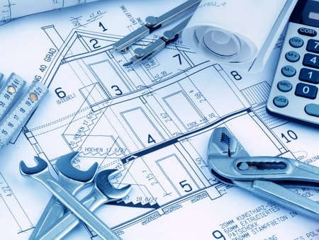 construction draftsman: an architect s blueprint with a calculator  symbolic photo for funding and planning of a new home  Stock Photo