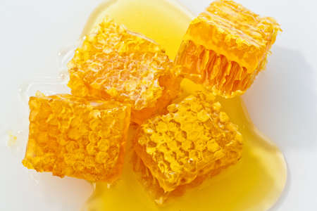 sweeten: honeycomb against white background  honey to sweeten