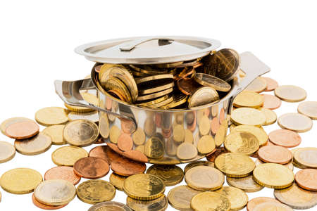 financially: a cooking pot is filled with euro coins, symbolic photo for funding