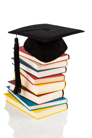 abroad: a mortarboard on a book stack Stock Photo