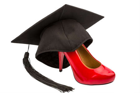 uni: a red ladies shoes on a mortarboard symbol photo for gender equality and women power Stock Photo