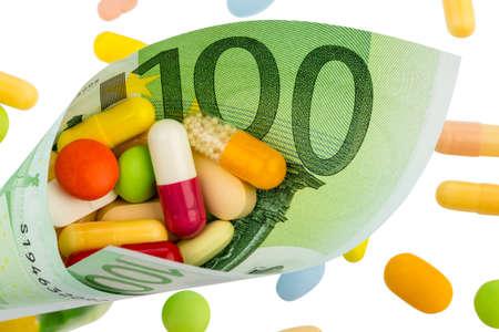 one hundred euro banknote: tabletas y billete de cien euros coste foto simb?lica de la medicina y los medicamentos de la industria farmac?utica