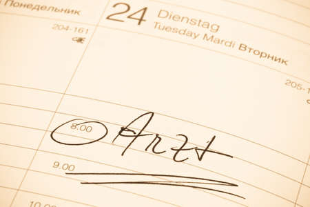 surgery expenses: a date is entered in a calendar  dentist Stock Photo