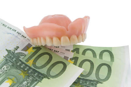 bribe: denture and euro bills, symbolic photo for dentures, treatment costs and payment Stock Photo