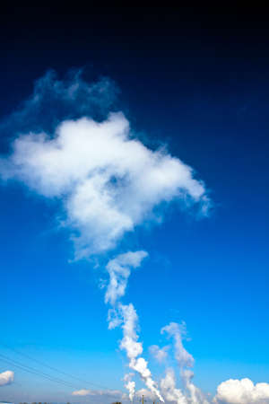 particulate: heavily smoking chimneys of an industrial company  pollution of the environment