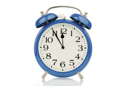 hectic: a blue alarm clock on a white background  five to twelve Stock Photo