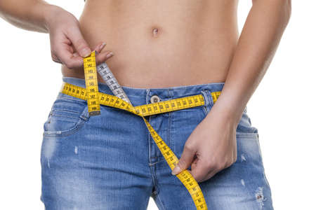 thinness: a young woman with a tape measure before the next diet  losing weight and fast
