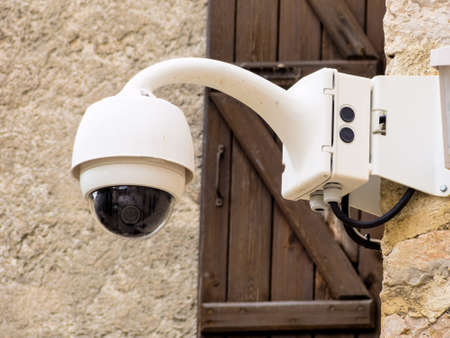 surveillance camera on a wall photo
