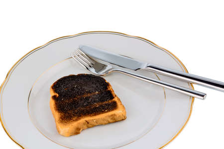 scorch: burnt toast on a plate Stock Photo
