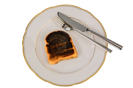 burnt toast: burnt toast on a plate Stock Photo