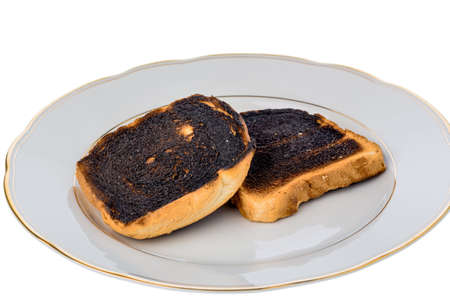 scorch: burnt toasts on a plate