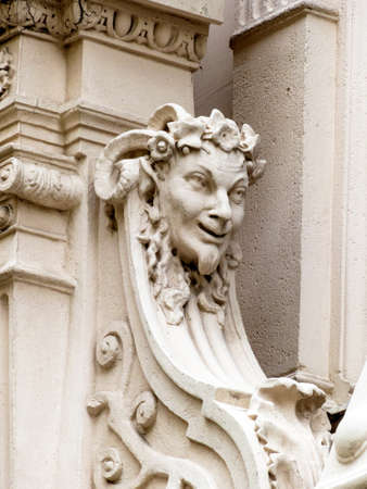 unsightly: sculptures on the facade of an old building in vienna