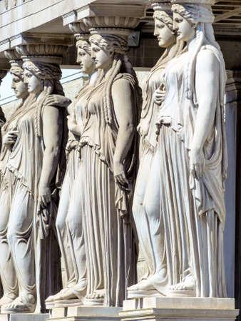 the austrian parliament statues in vienna photo