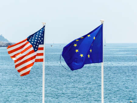 politically: flags of the european union and the united states