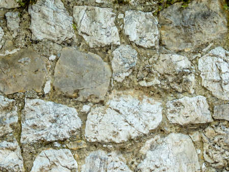 substantiate: an old stone wall as background