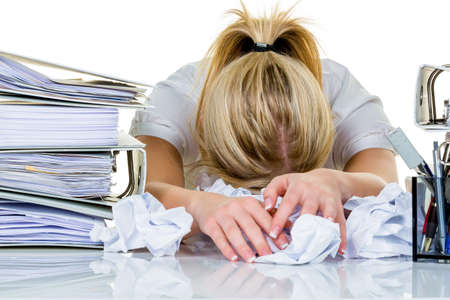 overwhelmed: young woman in office is overwhelmed with work  burnout in work or study  Stock Photo