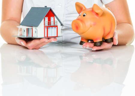 single familiy: una mujer con una casa y una hucha