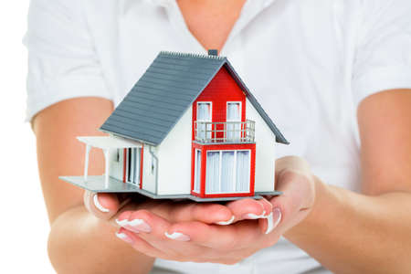 single familiy: a broker for real estate with a house and a key  successful leasing and property for sale by real estate agents  Stock Photo