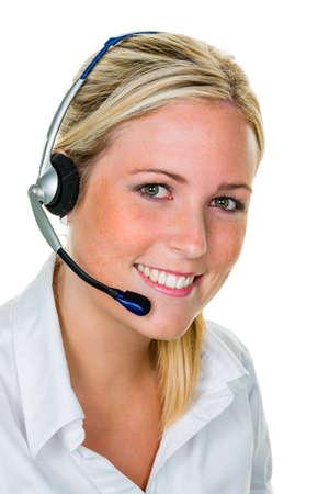 주문 접수의 판매 및 고객 서비스 사무실에서 전화 헤드셋을 가진 젊은 여자 스톡 콘텐츠