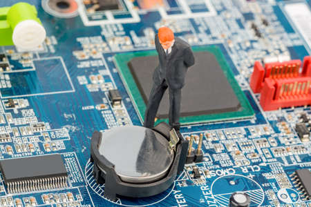a manager checking computer on a circuit board photo