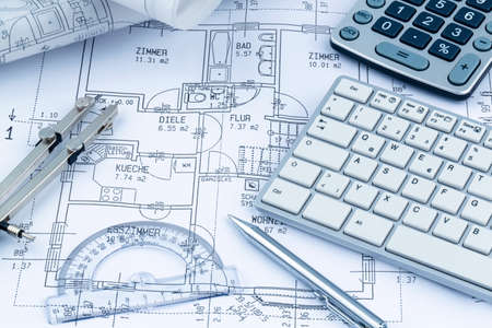 construction draftsman: a subkey hits a home is located on a house plan Stock Photo