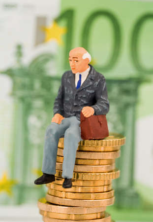 private insurance: a pensioner sitting on coins