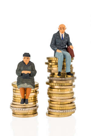 pensioners and pensioner at different levels of money stacks photo