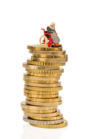 woman in wheelchair on money stack photo