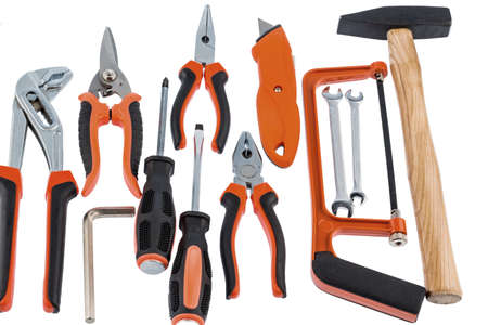 different tools of a craftsman lie side by side on white background photo