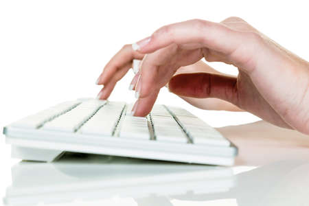 tablet pc in hand: woman in office with computer  typing on a keyboard