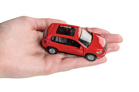fully comprehensive: hand keeps model of a car Stock Photo